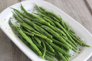 Simple side of steamed green beans finished with black sea salt.